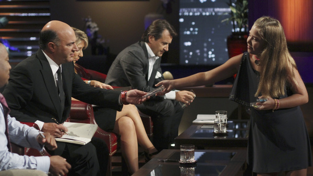 SHARK TANK - &quot;Episode 303&quot; - A family from Dallas, TX asks the Sharks to invest in their jewelry line business &quot;for girls aged 8 to 80,&quot; created by one of the daughters when she was only 10 years old; a couple from Waldwich, NJ hopes the Sharks will agree to put a lid on their solution to replace missing garbage can lids; a single working mom from Wellington, FL pitches her wedge-type pillow that allows women with breast implants or large chests to comfortably sleep on their stomachs; and two gentlemen from Chicago, IL offer the Sharks a cup of couture with their reinvention of the tea experience. In a follow up story, George Podd from Lake Forest, IL shows how &quot;Shark Tank&quot; made the American dream come true for Lightfilm, a peel &amp; stick light-up decal for car windows, on &quot;Shark Tank,&quot; FRIDAY, FEBRUARY 17 (8:00-9:00 p.m., ET) on the ABC Television Network. (ABC/MICHAEL ANSELL)KEVIN O'LEARY, LORI GREINER, ROBERT HERJAVEC