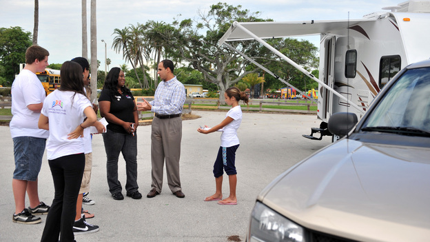 "SECRET MILLIONAIRE - ""Marcus Lemonis, Miami, FL"" - CEO & Chairman of Camping World and Good Sam touches the lives of many when he returns to a very disadvantaged community of his Miami childhood hometown to secretly seek out those most in need. Over the course of seven days, this billion dollar business owner leaves his luxurious Chicago lifestyle and moves into a rundown trailer at welfare level wages. While there, he volunteers and gets to know some selfless heroes who are sacrificing their time, energy and money to provide a good home for young women at risk and to clothe children living in poverty. At week's end, Marcus gifts these amazing people with hundreds of thousands of dollars of his own money and confesses to having had ""the single greatest experience of his life,"" on ""Secret Millionaire,"" SUNDAY, AUGUST 5 (8:00-9:00 p.m., ET), on The ABC Television Network. (ABC/RODRIGO VARELA)NVEEE KIDS, JOWHARAH SANDERS, MARCUS LEMONIS"