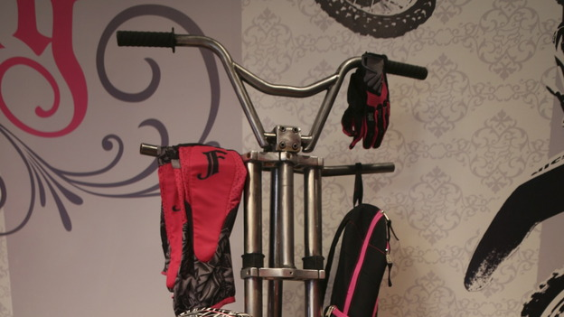 Paige's Bicycle Coat RackMaterials:- Drill- Grinder- Metal cutting saw- WelderTools Needed:- 24&quot; Bicycle Tire- 6' 2&quot; black iron pipe- Old bicycle- 3/8&quot; steel rod- Satin clear coat (spray)Procedure    Weld the black iron pipe to the center hub of the bicycle tire.  Make sure that it is 90 degrees from the ground.    Take the bicycle apart.  Grind and clean all bicycle parts.  The top portion of the coat rack is made with handle bars.  Weld or bolt the handle bars to the top of the pipe, about five and a half feet from the floor.    Decide what parts you want to attach to the main shaft of the rack.  We used the bike body and lower handle bar assembly.  Bolt or weld the parts to the pipe.    Make sure the pipe is ridged with the base.  If needed, make forty five degree supports out of the 3/8&quot; rod.  They are attached about two feet above the floor on the pipe.  The bottoms of the supports attach to the rim of the tire base.    Add any extra parts that you would like along the body of the coat rack.    Once assembled, the whole rack should be sprayed with a satin clear coat.   