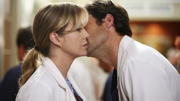 "GREY'S ANATOMY - ""Here Comes the Flood"" - Derek gives Meredith a kiss on the cheek after telling her he plans to kick Alex and Izzie out of the house, on ""Grey's Anatomy,"" THURSDAY, OCTOBER 9 (9:00-10:01 p.m., ET) on the ABC Television Network. (ABC/DANNY FELD) ELLEN POMPEO, PATRICK DEMPSEY"