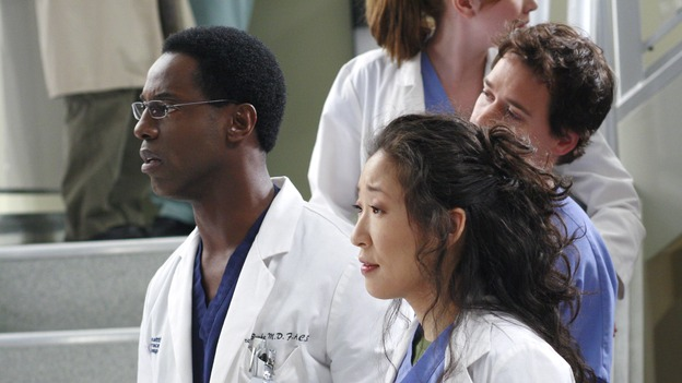 "GREY'S ANATOMY - ""Scars and Souvenirs"" - The race for chief heats up after a new competitor enters the fray, tensions escalate between Izzie and George, and Callie must reveal a big secret. Meanwhile, Derek treats a patient near and dear to him, while Alex continues his work with Jane Doe, on ""Grey's Anatomy,"" THURSDAY, MARCH 15 (9:00-10:01 p.m., ET) on the ABC Television Network. (ABC/RON TOM)ISAIAH WASHINGTON, SANDRA OH, T.R. KNIGHT"