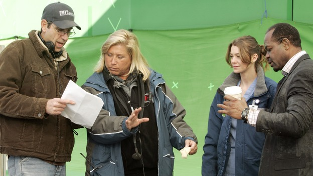 "GREY'S ANATOMY - ""Walk on Water"" - Producer/director Rob Corn, producer/technical advisor Linda Klein (center left), and Ellen Pompeo (center right) review notes while shooting ""Grey's Anatomy"" on location at the Santa Anita Park in Arcadia, California. (ABC/VIVIAN ZINK)"