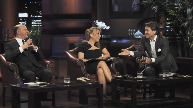 "SHARK TANK - ""Episode 304"" - ""Queen of QVC"" Lori Greiner jumps into the Tank as a guest Shark and makes TV history when she does something no Shark before has ever done. Segments include a wife and mother from Ladera Ranch, CA hit hard by the recession, who makes an impassioned pitch of her unique towel design that provides coverage when changing out of a swimsuit in public places; a woman from Irvine, CA shows the Sharks her business idea -- a sweater and quilt invention called the ""Swilt""; a wine connoisseur from Mason, OH shows a unique way to maximize the life of a beloved beverage; and a woman from Grove City, PA presents a natural and healthy cake mix - for dogs. In the biggest success story of ""Shark Tank"" to date, Sean Conway and DJ Stephan talk about the sale of their company, Notehall, an online marketplace where college students can buy and sell class notes, on ""Shark Tank,"" FRIDAY, FEBRUARY 10 (8:00-9:00 p.m., ET) on the ABC Television Network. (ABC/MICHAEL ANSELL)KEVIN O'LEARY, LORI GREINER, ROBERT HERJAVEC"