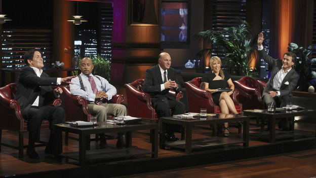 SHARK TANK - &quot;Episode 303&quot; - A family from Dallas, TX asks the Sharks to invest in their jewelry line business &quot;for girls aged 8 to 80,&quot; created by one of the daughters when she was only 10 years old; a couple from Waldwich, NJ hopes the Sharks will agree to put a lid on their solution to replace missing garbage can lids; a single working mom from Wellington, FL pitches her wedge-type pillow that allows women with breast implants or large chests to comfortably sleep on their stomachs; and two gentlemen from Chicago, IL offer the Sharks a cup of couture with their reinvention of the tea experience. In a follow up story, George Podd from Lake Forest, IL shows how &quot;Shark Tank&quot; made the American dream come true for Lightfilm, a peel &amp; stick light-up decal for car windows, on &quot;Shark Tank,&quot; FRIDAY, FEBRUARY 17 (8:00-9:00 p.m., ET) on the ABC Television Network. (ABC/MICHAEL ANSELL)MARK CUBAN, DAYMOND JOHN, KEVIN O'LEARY, LORI GREINER, ROBERT HERJAVEC