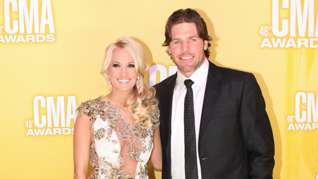 "THE 46TH ANNUAL CMA AWARDS - RED CARPET ARRIVALS - ""The 46th Annual CMA Awards"" airs live THURSDAY, NOVEMBER 1 (8:00-11:00 p.m., ET) on ABC live from the Bridgestone Arena in Nashville, Tennessee. (ABC/SARA KAUSS)CARRIE UNDERWOOD, MIKE FISHER"