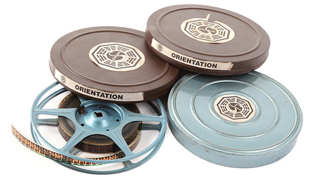 Set of three (3) DHARMA Initiative orientation films from the Swan stationSet of three (3) DHARMA Initiative orientation films with cans featuring DHARMA Swan station logo. The 16mm films are created for the occupants of the various stations throughout the Island, most of them featuring Pierre Chang under various aliases. They are first introduced when Jack, Locke and Kate enter the Swan station. After the confrontation with Desmond, they are directed to watch a short film narrated by a scientist named Dr. Marvin Candle. It is then that the Survivors initially learn about the existence of the DHARMA Initiative.