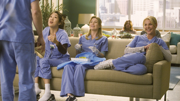 "GREY'S ANATOMY - ""Brave New World"" - Cristina, Meredith and Izzie try to explain the appeal of Dermatology to George, on ""Grey's Anatomy,"" THURSDAY, OCTOBER 16 (9:00-10:01 p.m., ET) on the ABC Television Network. (ABC/RANDY HOLMES) SANDRA OH, ELLEN POMPEO, KATHERINE HEIGL"