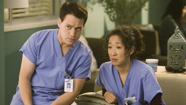 "GREY'S ANATOMY - ""Brave New World"" - Cristina introduces George to the strange world of Dermatology, on ""Grey's Anatomy,"" THURSDAY, OCTOBER 16 (9:00-10:01 p.m., ET) on the ABC Television Network. (ABC/RANDY HOLMES) T.R. KNIGHT, SANDRA OH"