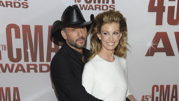 "THE 45th ANNUAL CMA AWARDS - RED CARPET ARRIVALS - ""The 45th Annual CMA Awards"" will broadcast live on ABC from the Bridgestone Arena in Nashville on WEDNESDAY, NOVEMBER 9 (8:00-11:00 p.m., ET). (ABC/JASON KEMPIN)TIM MCGRAW, FAITH HILL"