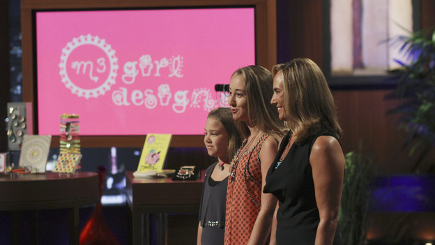 "SHARK TANK - ""Episode 303"" - A family from Dallas, TX asks the Sharks to invest in their jewelry line business ""for girls aged 8 to 80,"" created by one of the daughters when she was only 10 years old; a couple from Waldwich, NJ hopes the Sharks will agree to put a lid on their solution to replace missing garbage can lids; a single working mom from Wellington, FL pitches her wedge-type pillow that allows women with breast implants or large chests to comfortably sleep on their stomachs; and two gentlemen from Chicago, IL offer the Sharks a cup of couture with their reinvention of the tea experience. In a follow up story, George Podd from Lake Forest, IL shows how ""Shark Tank"" made the American dream come true for Lightfilm, a peel & stick light-up decal for car windows, on ""Shark Tank,"" FRIDAY, FEBRUARY 17 (8:00-9:00 p.m., ET) on the ABC Television Network. (ABC/MICHAEL ANSELL)MADDIE BRADSHAW AND DIANE BRADSHAW (M3 GIRL DESIGNS)"