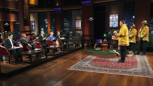 "SHARK TANK -""Episode 204"" -- Tempers flare when guest Shark Mark Cuban urges the entrepreneurs to stop negotiating with the other Sharks if they even want a chance to make a business deal with him. In this episode, a fireman from Arkansas brings an invention to the Shark Tank that could make millions and save lives; after creating an eco-friendly way to listen to music on the go, a duo from Chicago hope the Sharks will want to invest; a feisty, combative entrepreneur from Montclair, New Jersey seeks to cash in on the lucrative wedding business; and a man from Oklahoma hopes the Sharks will smell the money when he pitches his unique male-oriented brand of candles, on ""Shark Tank,"" FRIDAY, MAY 6 (8:00-9:00 p.m., ET) on the ABC Television Network. (ABC/CRAIG SJODIN)MARK CUBAN, DAYMOND JOHN, KEVIN O'LEARY, BARBARA CORCORAN, ROBERT HERJAVEC, JEFF STROOPE (HYCONN LLC.)"