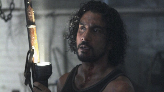 LOST - &quot;Enter 77&quot; - Locke, Sayid and Kate investigate a strange structure and its mysterious inhabitant. Meanwhile, Sawyer competes in a ping-pong competition to get back his belongings, on &quot;Lost,&quot; WEDNESDAY, MARCH 7 (10:00-11:00 p.m., ET), on the ABC Television Network. (ABC/MARIO PEREZ)NAVEEN ANDREWS