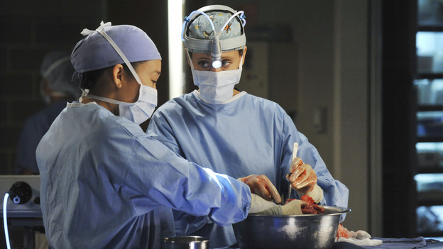 GREY'S ANATOMY - &quot;Shock to the System&quot; -- After weeks of concealing the fact she was pregnant and miscarried, Meredith at last tells Derek and is finally cleared to return to her surgical duties in the wake of the hospital shooting spree; Cristina experiences post-traumatic stress disorder in the midst of an operation; and Bailey refuses to let Alex operate until he agrees to have the bullet in his chest removed, on &quot;Grey's Anatomy,&quot; THURSDAY, SEPTEMBER 30 (9:00-10:01 p.m., ET) on the ABC Television Network. (ABC/ERIC MCCANDLESS)SANDRA OH, KIM RAVER