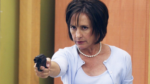 Not-So-Sweet CarolynNora blurts out to a gun-wielding Carolyn Bigsby that Lynette is trying to steal her daughter. Lynette mentions that Nora put the moves on her husband. This is the wrong thing to say to an unhinged woman dealing with an unfaithful hubby. Carolyn coldly raises the gun and shoots Nora in the chest. A dying Nora begs Lynette to raise Kayla, the only good thing she's ever done in her life. Her heartfelt plea had us in tears. She truly loved her daughter. As Nora dies, Lynette screams at Carolyn. Things have escalated to a critical level. 