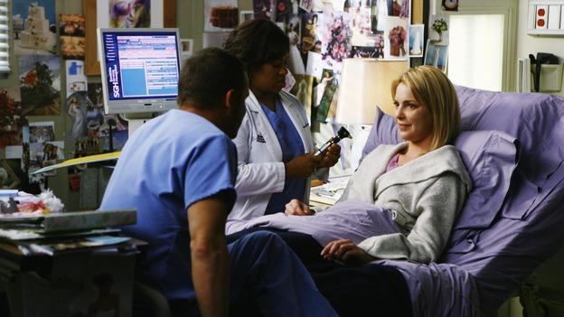 GREY'S ANATOMY - &quot;What a Difference a Day Makes&quot; - Bailey examines Izzie in order to clear her to go to Meredith and Derek's wedding, on &quot;Grey's Anatomy,&quot; THURSDAY, MAY 7 (9:00-10:02 p.m., ET) on the ABC Television Network. (ABC/SCOTT GARFIELD) JUSTIN CHAMBERS, CHANDRA WILSON, KATHERINE HEIGL