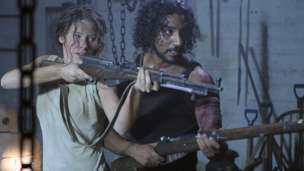 LOST - &quot;Enter 77&quot; - Locke, Sayid and Kate investigate a strange structure and its mysterious inhabitant. Meanwhile, Sawyer competes in a ping-pong competition to get back his belongings, on &quot;Lost,&quot; WEDNESDAY, MARCH 7 (10:00-11:00 p.m., ET), on the ABC Television Network. (ABC/MARIO PEREZ)EVANGELINE LILLY, NAVEEN ANDREWS