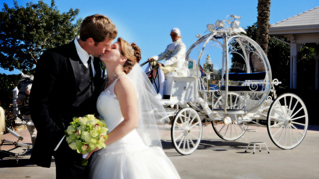 Melissa and Larry share a moment before riding away in Cinderella's Coach. www.disneyweddings.com