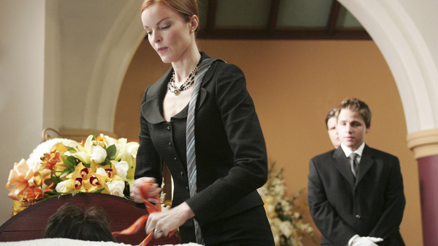 "DESPERATE HOUSEWIVES ""Next"" - Bree fixing her dead husband's tie at his funeral - (ABC/VIVIAN ZINK) MARCIA CROSS, SHAWN PYFROM"