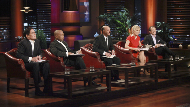 "SHARK TANK - 'Episode 312"" - The Sharks start a feeding frenzy for a chance to go into the residential lock business with a man from Orlando, FL who invented a way to incorporate the common key into a mobile phone. Two fitness trainers from Medina, OH hope to convince the Sharks their home gym is better since it provides nitrogen gas-pressured resistance. A young man from Trophy Club, TX asks the Sharks to invest in his age-defying products that were inspired by his older girlfriend. A father from Charlotte, NC designed a 100% recycled sneaker and hopes to get a business deal that he can eventually pass on to his two young sons. Also, a follow-up on Daymond and Mark's Season 3 investment with Alashe Nelson from Miami, FL and his EZ VIP website - where you can buy VIP treatment at nightclubs and special events. Daymond introduces Alashe to Pit Bull, the international superstar who will endorse the business, on the Season Finale of ""Shark Tank,"" FRIDAY, MAY 18 (8:00-9:01 p.m., ET) on the ABC Television Network.  (ABC/RICHARD CARTWRIGHT) MARK CUBAN, DAYMOND JOHN, KEVIN O'LEARY, BARBARA CORCORAN, ROBERT HERJAVEC"