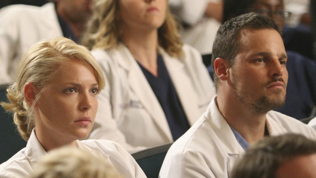 GREY'S ANATOMY - &quot;Here Comes the Flood&quot; - Alex and Izzie listen to the Chief lay out his new rules for SGH, on &quot;Grey's Anatomy,&quot; THURSDAY, OCTOBER 9 (9:00-10:01 p.m., ET) on the ABC Television Network. (ABC/DANNY FELD) ERIC DANE (BACKGROUND), KATHERINE HEIGL, BROOKE SMITH, JUSTIN CHAMBERS