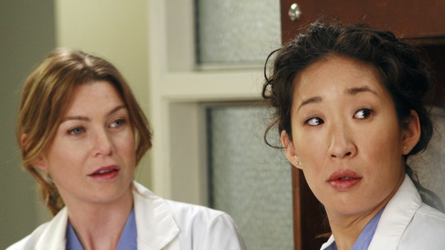 "GREY'S ANATOMY - ""Haunt You Every Day"" - It's Halloween, and the day is full of surprises for the doctors of Seattle Grace - Alex receives an unexpected and welcome visit from his former patient, Ava/Rebecca, Meredith is convinced that her mother's ashes are haunting her, Cristina is snubbed by a surgeon she admires, and Callie announces George and Izzie's affair to their fellow doctors, on ""Grey's Anatomy,"" THURSDAY, OCTOBER 25 (9:00-10:02 p.m., ET) on the ABC Television Network. (ABC/RON TOM)ELLEN POMPEO, SANDRA OH"