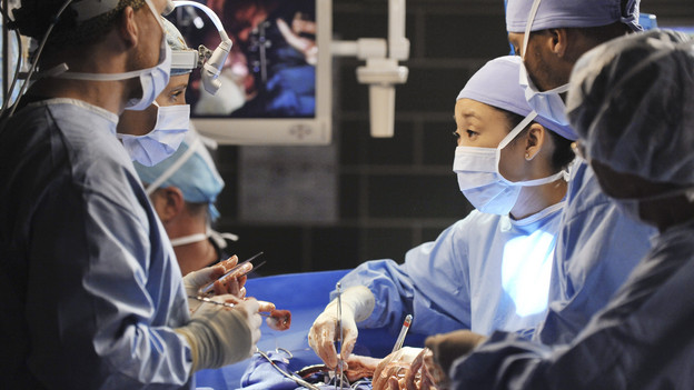 "GREY'S ANATOMY - ""Shock to the System"" -- After weeks of concealing the fact she was pregnant and miscarried, Meredith at last tells Derek and is finally cleared to return to her surgical duties in the wake of the hospital shooting spree; Cristina experiences post-traumatic stress disorder in the midst of an operation; and Bailey refuses to let Alex operate until he agrees to have the bullet in his chest removed, on ""Grey's Anatomy,"" THURSDAY, SEPTEMBER 30 (9:00-10:01 p.m., ET) on the ABC Television Network. (ABC/ERIC MCCANDLESS)KEVIN MCKIDD, KIM RAVER, SANDRA OH, JESSE WILLIAMS"