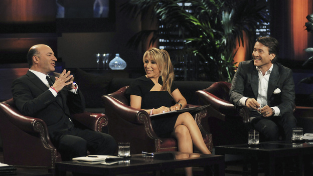 "SHARK TANK - ""Episode 302"" - The Sharks tear into the business idea of a Phoenix, AZ man who wants them to invest in a watch he claims provides health benefits; a stay-at-home mom from Gilbert, AZ could lose her gourmet pretzel business if she leaves the Tank without an investor; a man from Bozeman, MT with a no-tools-required furniture system hopes he can assemble a deal; and an inventor from Fullerton, CA has a small but powerful idea that could make him a millionaire. Also, Johnson Barley from Broken Arrow, OK, whose Original Man Candle did not spark a deal with the Sharks in Season Two, talks about his business since his appearance, on ""Shark Tank,"" FRIDAY, FEBRUARY 24 (8:00-9:00 p.m., ET) on the ABC Television Network. (ABC/MICHAEL ANSELL)KEVIN O'LEARY, LORI GREINER, ROBERT HERJAVEC"