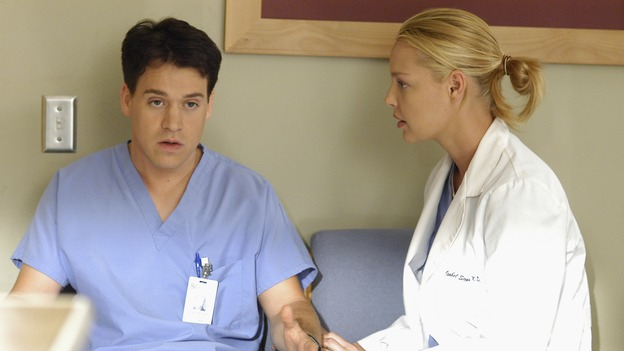 "GREY'S ANATOMY - ""Let the Truth Sting"" - The new interns are dazzled by the skill level of fellow intern George, while Lexie helps keep his ""repeater"" status a secret; Meredith half-heartedly helps Lexie with her first emergency patient; Sloan and Richard attempt a radical, new surgery to save a woman's ability to speak; and George is compelled to tell Callie of his past indiscretion with Izzie, on ""Grey's Anatomy,"" THURSDAY, OCTOBER 11 (9:00-10:01 p.m., ET) on the ABC Television Network.  (ABC/GALE ADLER)T.R. KNIGHT, KATHERINE HEIGL"