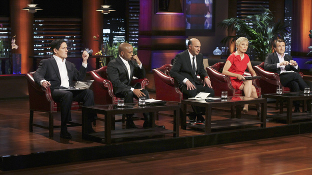 "SHARK TANK - ""Episode 313"" - The inventor of Rollerblades hopes to get investment money to put toward his newest invention, an elevated mono-rail bike system. An amazing story from a Rochester, NY businesswoman who hopes her dream comes true and strikes a deal for her innovative shoe accessories that can turn any shoe into a boot. A man from Buena Park, CA must convince the Sharks that there is a market for a custom made air mattress that fits in the back of a pickup truck; and a fashion designer from Dallas, TX has over a billion reasons the Sharks should see the value in his customized cruiser bikes that can be designed on an interactive website. There is a follow-up on Ladera Ranch, California's Shelly Ehler and her ShowNo, a unique towel design that provides coverage when changing out of a swimsuit in public places, which Lori Greiner invested in during Season 3, on ""Shark Tank,"" FRIDAY, MAY 4 (8:00-9:01 p.m., ET) on the ABC Television Network. (ABC/MICHAEL ANSELL)MARK CUBAN, DAYMOND JOHN, KEVIN O'LEARY, BARBARA CORCORAN, ROBERT HERJAVEC"