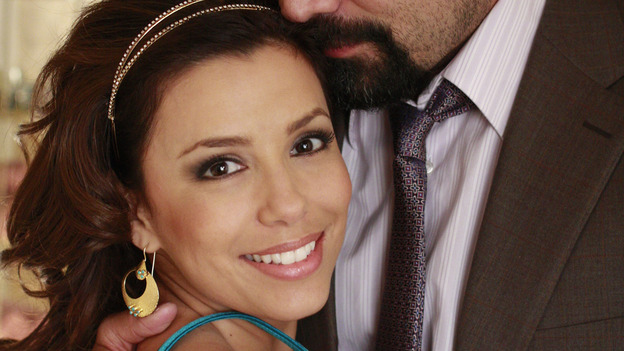 "DESPERATE HOUSEWIVES - Ricardo Antonio Chavira (""Carlos"") and Eva Longoria Parker (""Gabrielle"") goof around on the set of ""Desperate Housewives"" during the filming of the two-hour Season Finale airing on Sunday, May 18 (9:00-11:00 p.m., ET), on the ABC Television Network. (ABC/RON TOM) EVA LONGORIA PARKER, RICARDO ANTONIO CHAVIRA"
