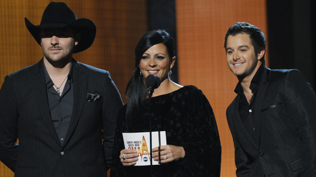 "THE 44TH ANNUAL CMA AWARDS - THEATRE - ""The 44th Annual CMA Awards"" were broadcast live from the Bridgestone Arena in Nashville, WEDNESDAY, NOVEMBER 10 (8:00-11:00 p.m., ET) on the ABC Television Network. (ABC/KATHERINE BOMBOY)CHRIS YOUNG, SARA EVANS, EASTON CORBIN"