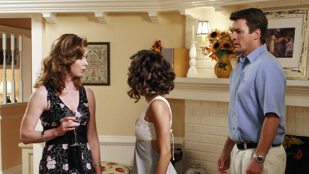 DESPERATE HOUSEWIVES - &quot;The Game&quot; - Dana does not like how handsy Gaby is being with her husband Adam. SUNDAY, OCTOBER 14 (9:00-10:01 p.m., ET) on the ABC Television Network. (ABC/RON TOM) DANA DELANY, EVA LONGORIA, NATHAN FILLION