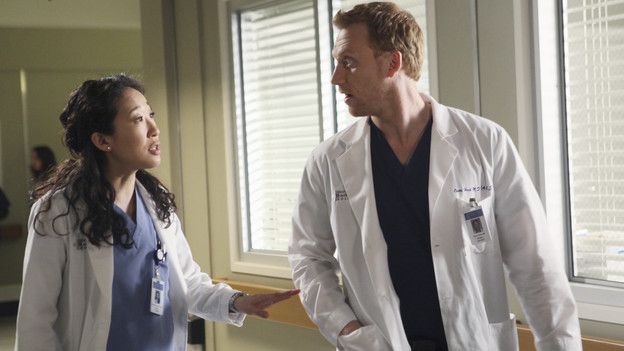 "GREY'S ANATOMY - ""Hook, Line and Sinner"" - Sloan returns to Mark's apartment, just as she's going into labor, and Teddy, Mark and the still-fighting Callie and Arizona are there to help with the birth and to get Mark through his grandson's pending adoption. Meanwhile Teddy sees Derek's invitation to illustrious cardiothoracic surgeon Tom Evans' as a threat to her future employment at the hospital, and the team work on a crab boat captain who has been stabbed with a giant shark hook, on ""Grey's Anatomy,"" THURSDAY, APRIL 29 (9:00-10:01 p.m., ET) on the ABC Television Network. (ABC/DANNY FELD) SANDRA OH, KEVIN MCKIDD"
