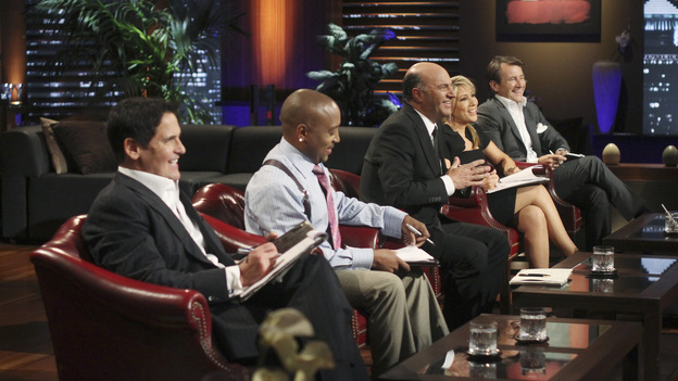 "SHARK TANK - ""Episode 302"" - The Sharks tear into the business idea of a Phoenix, AZ man who wants them to invest in a watch he claims provides health benefits; a stay-at-home mom from Gilbert, AZ could lose her gourmet pretzel business if she leaves the Tank without an investor; a man from Bozeman, MT with a no-tools-required furniture system hopes he can assemble a deal; and an inventor from Fullerton, CA has a small but powerful idea that could make him a millionaire. Also, Johnson Barley from Broken Arrow, OK, whose Original Man Candle did not spark a deal with the Sharks in Season Two, talks about his business since his appearance, on ""Shark Tank,"" FRIDAY, FEBRUARY 24 (8:00-9:00 p.m., ET) on the ABC Television Network. (ABC/MICHAEL ANSELL)MARK CUBAN, DAYMOND JOHN, KEVIN O'LEARY, LORI GREINER, ROBERT HERJAVEC"