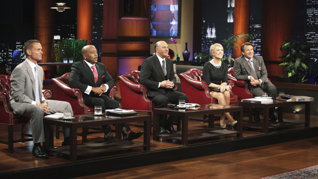 SHARK TANK - &quot;Episode 208&quot; -- A woman from Yardley, Pennsylvania could help cat lovers everywhere if the Sharks invest in her toilet training kit for cats, and the Sharks fight each other for a piece of a multi-million dollar company owned by a pharmacist from Palm Beach Gardens, Florida, who has invented a shoe with interchangeable tops. Also in this episode, an entrepreneur from Chicago is hoping to reposition her once successful designer line of maternity t-shirts; and an artist originally from Mexico City (now living in Chicago) and eager to make his American dream come true hopes the Sharks will want to invest in his line of extravagant yet affordable jewelry. In addition there will be a follow up from Season 1 on the father and son team behind Voyage Air Guitar and what happened to their business after turning down the Sharks' $1 million dollar offer, on the Season Finale of &quot;Shark Tank,&quot; FRIDAY, MAY 13 (8:00-9:00 p.m., ET) on the ABC Television Network. (ABC/ADAM TAYLOR)KEVIN HARRINGTON, DAYMOND JOHN, KEVIN O'LEARY, BARBARA CORCORAN, ROBERT HERJAVEC