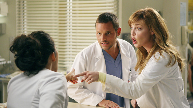 "GREY'S ANATOMY - ""I Always Feel Like Somebody's Watchin' Me"" - Several weeks after her near-death experience, a recovering Izzie returns to work. Meanwhile, nervous that there will be layoffs in the hospital in the wake of an announcement from the Chief, the Seattle Grace residents compete to survive the cuts, including Cristina, who attempts to work alongside Arizona in pediatrics. And Bailey and Alex's patient's already complex case is further complicated by her schizophrenic son, on ""Grey's Anatomy,"" THURSDAY, OCTOBER 1 (9:00-10:01 p.m., ET) on the ABC Television Network. (ABC/CRAIG SJODIN)SANDRA OH, JUSTIN CHAMBERS, KATHERINE HEIGL"