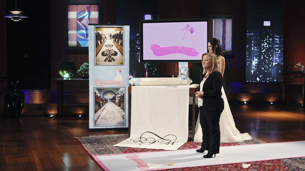 SHARK TANK -&quot;Episode 204&quot; -- Tempers flare when guest Shark Mark Cuban urges the entrepreneurs to stop negotiating with the other Sharks if they even want a chance to make a business deal with him. In this episode, a fireman from Arkansas brings an invention to the Shark Tank that could make millions and save lives; after creating an eco-friendly way to listen to music on the go, a duo from Chicago hope the Sharks will want to invest; a feisty, combative entrepreneur from Montclair, New Jersey seeks to cash in on the lucrative wedding business; and a man from Oklahoma hopes the Sharks will smell the money when he pitches his unique male-oriented brand of candles, on &quot;Shark Tank,&quot; FRIDAY, MAY 6 (8:00-9:00 p.m., ET) on the ABC Television Network. (ABC/CRAIG SJODIN)JULIE GOLDMAN (ORIGINAL RUNNER CO.)