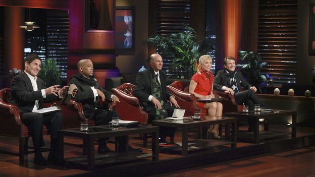 "SHARK TANK - ""Episode 313"" - The inventor of Rollerblades hopes to get investment money to put toward his newest invention, an elevated mono-rail bike system. An amazing story from a Rochester, NY businesswoman who hopes her dream comes true and strikes a deal for her innovative shoe accessories that can turn any shoe into a boot. A man from Buena Park, CA must convince the Sharks that there is a market for a custom made air mattress that fits in the back of a pickup truck; and a fashion designer from Dallas, TX has over a billion reasons the Sharks should see the value in his customized cruiser bikes that can be designed on an interactive website. There is a follow-up on Ladera Ranch, California's Shelly Ehler and her ShowNo, a unique towel design that provides coverage when changing out of a swimsuit in public places, which Lori Greiner invested in during Season 3, on ""Shark Tank,"" FRIDAY, MAY 4 (8:00-9:01 p.m., ET) on the ABC Television Network. (ABC/RICHARD CARTWRIGHT)MARK CUBAN, DAYMOND JOHN, KEVIN O'LEARY, BARBARA CORCORAN, ROBERT HERJAVEC"