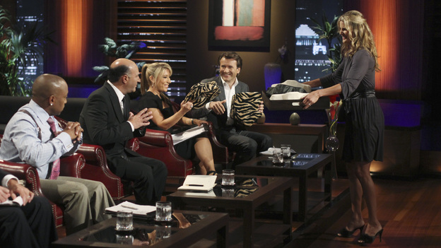 SHARK TANK - &quot;Episode 303&quot; - A family from Dallas, TX asks the Sharks to invest in their jewelry line business &quot;for girls aged 8 to 80,&quot; created by one of the daughters when she was only 10 years old; a couple from Waldwich, NJ hopes the Sharks will agree to put a lid on their solution to replace missing garbage can lids; a single working mom from Wellington, FL pitches her wedge-type pillow that allows women with breast implants or large chests to comfortably sleep on their stomachs; and two gentlemen from Chicago, IL offer the Sharks a cup of couture with their reinvention of the tea experience. In a follow up story, George Podd from Lake Forest, IL shows how &quot;Shark Tank&quot; made the American dream come true for Lightfilm, a peel &amp; stick light-up decal for car windows, on &quot;Shark Tank,&quot; FRIDAY, FEBRUARY 17 (8:00-9:00 p.m., ET) on the ABC Television Network. (ABC/MICHAEL ANSELL)DAYMOND JOHN, KEVIN O'LEARY, LORI GREINER, ROBERT HERJAVEC