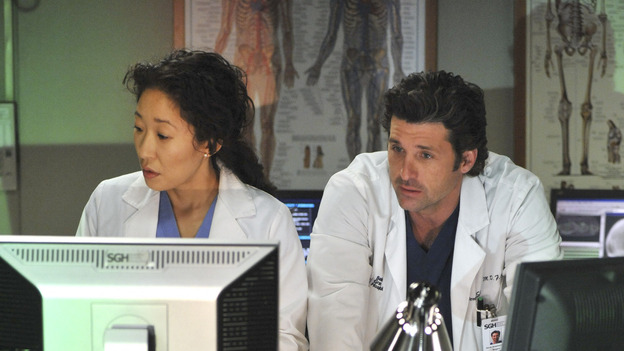 GREY'S ANATOMY- &quot;Here Comes the Flood&quot; - Cristina and&nbsp;Derek check a patient's test results, on &quot;Grey's Anatomy,&quot; THURSDAY, OCTOBER 9 (9:00-10:01 p.m., ET) on the ABC Television Network. (ABC/ERIC McCANDLESS) SANDRA OH, DANIEL J. TRAVANTI, PATRICK DEMPSEY