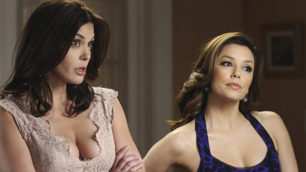 "DESPERATE HOUSEWIVES - ""A Little Night Music"" - Angie comes face to face with her ex, Patrick Logan (John Barrowman), after years on the run, SUNDAY, MAY 2 (9:00-10:01 p.m., ET) on ABC's ""Desperate Housewives."" Meanwhile, Gaby and Susan plan an elaborate scheme against their husbands, Lynette sees a darker side of Eddie, and Bree meets a woman who knows Sam all too well. (ABC/RON TOM) TERI HATCHER, EVA LONGORIA PARKER"