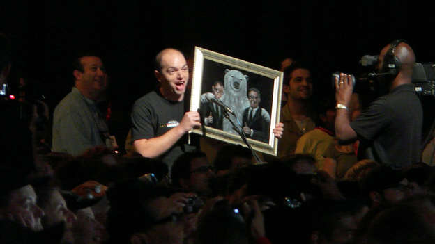 Comedian Paul Scheer was among the fans waiting in line to ask Damon and Carlton a question.  - Paul said he's been dedicating his time to create LOST art and showed his velvet painting of Damon, Carlton and a polar bear.  - Paul then promoted his website, damoncarltonandapolarbear.com. We're not sure what to expect from it or what other weird LOST sites will be popping up.  - Paul gave the painting to Damon and Carlton as a gift before running through the crowd yelling, &quot;Damon, Carlton and a Polar Bear.com!&quot;