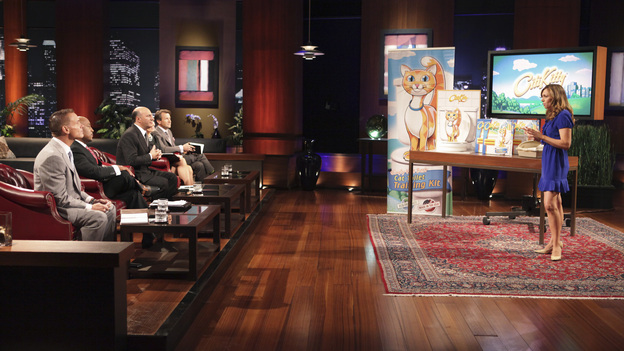 "SHARK TANK - ""Episode 208"" -- A woman from Yardley, Pennsylvania could help cat lovers everywhere if the Sharks invest in her toilet training kit for cats, and the Sharks fight each other for a piece of a multi-million dollar company owned by a pharmacist from Palm Beach Gardens, Florida, who has invented a shoe with interchangeable tops. Also in this episode, an entrepreneur from Chicago is hoping to reposition her once successful designer line of maternity t-shirts; and an artist originally from Mexico City (now living in Chicago) and eager to make his American dream come true hopes the Sharks will want to invest in his line of extravagant yet affordable jewelry. In addition there will be a follow up from Season 1 on the father and son team behind Voyage Air Guitar and what happened to their business after turning down the Sharks' $1 million dollar offer, on the Season Finale of ""Shark Tank,"" FRIDAY, MAY 13 (8:00-9:00 p.m., ET) on the ABC Television Network. (ABC/ADAM TAYLOR)KEVIN HARRINGTON, DAYMOND JOHN, KEVIN O'LEARY, BARBARA CORCORAN, ROBERT HERJAVEC, REBECCA RESCATE (CITIKITTY)"