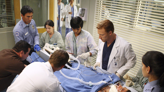 "GREY'S ANATOMY - ""I Always Feel Like Somebody's Watchin' Me"" - Several weeks after her near-death experience, a recovering Izzie returns to work. Meanwhile, nervous that there will be layoffs in the hospital in the wake of an announcement from the Chief, the Seattle Grace residents compete to survive the cuts, including Cristina, who attempts to work alongside Arizona in pediatrics. And Bailey and Alex's patient's already complex case is further complicated by her schizophrenic son, on ""Grey's Anatomy,"" THURSDAY, OCTOBER 1 (9:00-10:01 p.m., ET) on the ABC Television Network. (ABC/CRAIG SJODIN)KEVIN MCKIDD"