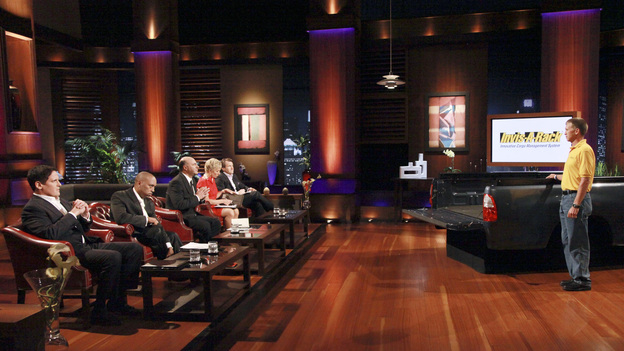 SHARK TANK - &quot;Episode 307&quot; - An artistic man from Chicago hopes the Sharks won't pussyfoot around but will see his cat drawing service as a worthy business investment. Another featured cat-themed business is a follow up story on CitiKitty from Season 2, Rebecca Rescate's product that potty trains cats. Also, a man from North Haven, CT needs to make the Sharks believe he has an education system that can teach anyone to be a better salesperson; a professional magician and Guinness World Record holder for card throwing, from Broadview Hills, OH presents his plan to bring his unique family-friendly brand of entertainment to Las Vegas; and a husband and father from Sparta, NC hopes to convince the Sharks to invest in his innovative cargo truck management system, a product he is proud to say is made in America, on &quot;Shark Tank,&quot; FRIDAY, JANUARY 27 (8:00-9:00 p.m., ET) on the ABC Television Network. (ABC/RICHARD CARTWRIGHT)MARK CUBAN, DAYMOND JOHN, KEVIN O'LEARY, BARBARA CORCORAN, ROBERT HERJAVEC, DONNY MCCALL (INVIS-A-RACK)