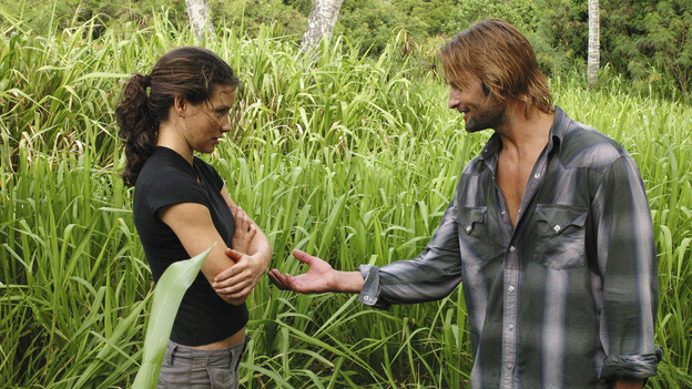 "LOST - ""Whatever the Case May Be"" - Jack, Kate and Sawyer fight over possession of a newly discovered locked metal briefcase which might contain insights into Kate's mysterious past. Meanwhile, Sayid asks a reluctant Shannon to translate notes he took from the French woman, a rising tide threatens to engulf the fuselage and the entire beach encampment, and Rose and a grieving Charlie tentatively bond over Claire's baffling disappearance, on ""Lost,"" WEDNESDAY, JANUARY 5 (8:00-9:00 p.m., ET), on the ABC Television Network.  (ABC/MARIO PEREZ) EVANGELINE LILLY, JOSH HOLLOWAY"