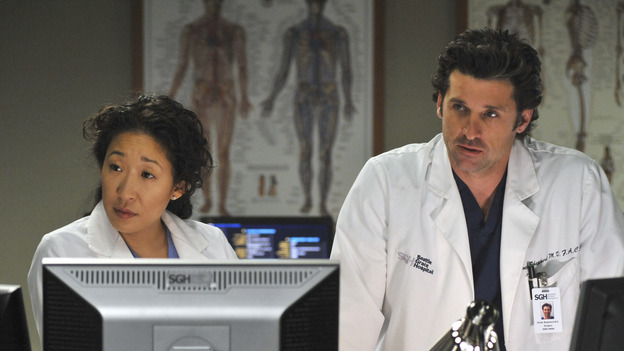 "GREY'S ANATOMY- ""Here Comes the Flood"" - Derek and Cristina perform a test on a patient, on ""Grey's Anatomy,"" THURSDAY, OCTOBER 9 (9:00-10:01 p.m., ET) on the ABC Television Network. (ABC/ERIC McCANDLESS) SANDRA OH, PATRICK DEMPSEY"