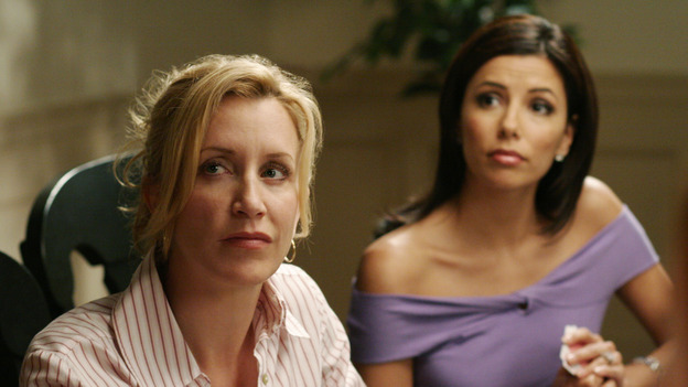"DESPERATE HOUSEWIVES - ""Goodbye for Now"" - Susan makes a decision about Mike Delfino. Meanwhile Lynette takes steps to make sure Annabel (guest star Melinda McGraw) doesn't come between her and Tom, Bree comes to a realization about ""buddy"" George the pharmacist (guest star Roger Bart), and Carlos' legal problems take a turn for the worse, on ""Desperate Housewives,"" SUNDAY, MAY 15 (9:00-10:02 p.m., ET) on the ABC Television Network. (ABC/RON TOM) FELICITY HUFFMAN, EVA LONGORIA"