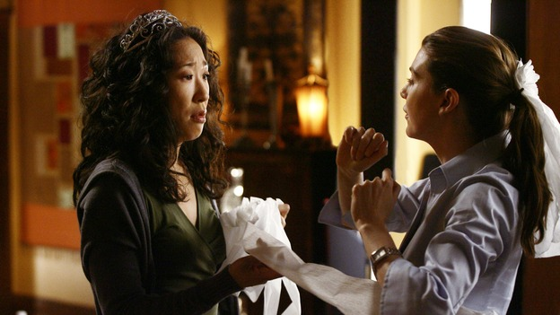GREY'S ANATOMY - &quot;Didn't We Almost Have It All&quot; - Cristina and Burke's wedding day arrives - along with the interns' first exam results - and a successor to the Chief is named, as Callie and George make a big decision about their relationship, on the Season Finale of &quot;Grey's Anatomy,&quot; THURSDAY, MAY 17 (9:00-10:07 p.m., ET) on the ABC Television Network. (ABC/SCOTT GARFIELD)SANDRA OH, ELLEN POMPEO
