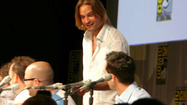 "You know what gets a crowd going? Josh Holloway (Sawyer) joining the LOST panel! After a montage of Sawyer clips, Josh walked onto the stage to join castmates Jorge Garcia, Michael Emerson and Nestor Carbonell.  - Josh came out and then reminded Damon and Carlton about the taser episode (""A Tale of Two Cities"").  - He then threatened Damon with a taser so he could get to the series finale script that Damon and Carlton had stashed away in a lockbox.  - Josh tasered Damon and took his key to the lockbox. He then told Carlton that he'd continue to taser his buddy over there, J.J. Abrams. Carlton replied that he tasered Damon Lindelof. ""Linda who?"" Josh exclaimed in full-on Sawyer mode.  - Josh was liberal with the Sawyer-inspired name-calling. He referred to Carlton as ""Frankenstein.""  - Josh opened the lockbox and tried to read the script. After much hesitation, an impatient Michael Emerson yelled, ""You can't read, can you?""  - Michael proceeded to read the finale script, but the joke is that it was actually a script for Heroes."